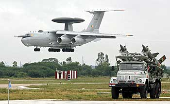 IAF surface to air missiles are displayed, as an IAF IL-76 aircraft configured with the new AWACS (Airborne Warning and Control Systems) prepares to land