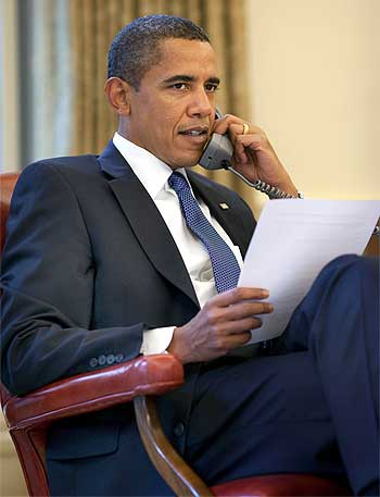 President Barack Obama on a phone call at the Oval Office