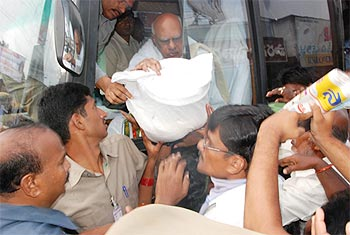 The CM gives out relief material to flood victims