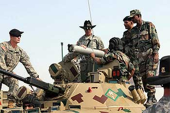 Indian Army soldiers and the American 14th Cavalry Regiment share information about vehicles and weapons systems