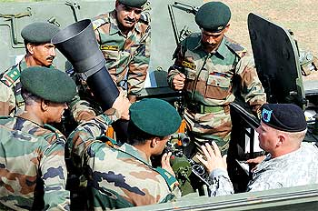 US soldiers share information on the stryker's mortar system with Indian soldiers