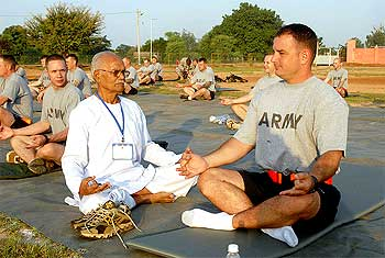 US soldiers take breathing advice from Ram Dhani Bajpai, yoga instructor