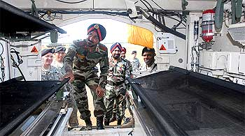 An Indian Army officer explores the inside of a Stryker vehicle