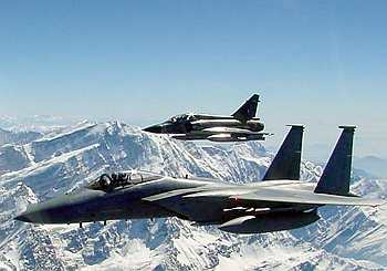 An F-15 Eagle and a Mirage 2000 fly together over the Himalayas during a wargame