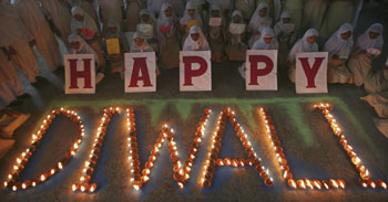 Muslim schoolgirls pose during celebrations to mark Diwali at a school in Ahmedabad