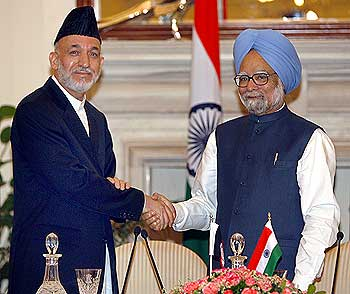 Afghanistan's incumbent President Hamid Karzai (left) with Indian Prime Minister Manmohan Singh