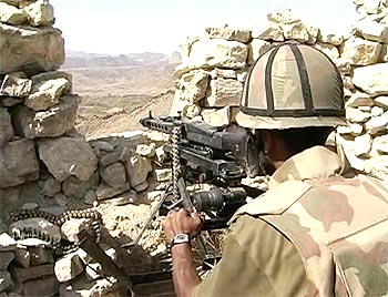 A Pakistani soldier mans a machine gun during a battle between security forces and Taliban militants in South Waziristan region