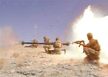 Pakistani soldiers fire an anti-tank gun during a battle between security forces and Taliban militants in the South Waziristan region