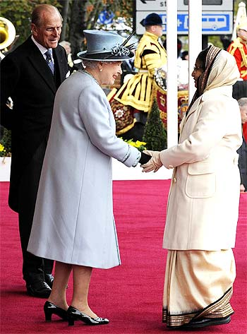 Britain's Queen Elizabeth greets President Pratibha Patil as Prince Philip watches in Windsor Castle