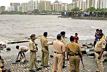 Policemen stand guard at the site off the Arabian Sea in south Mumbai where the terrorists are said to have landed on 26/11