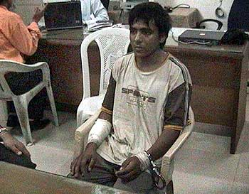 The lone surviving terrorist, Ajmal Kasab, in custody