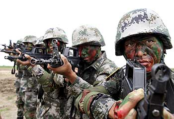 Chinese soldiers prepare for a joint anti-terror exercise with Russia in Taonan, July 14