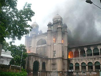 The court complex engulfed by flames
