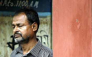 Masoom Ali, father of Mumtaz, another victim, waits outside the mortuary.