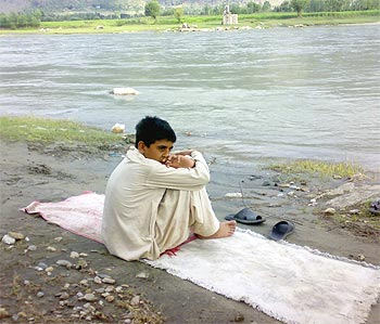 Akhtar Gul on the banks of the Swat River
