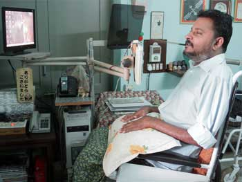 M P Anil Kumar at his desk at the Paraplegic Rehabilitation Centre in Pune