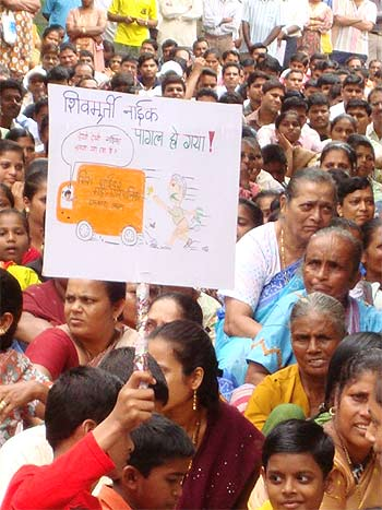 A protestor holds a placard against Mira-Bhayander Municipal Commissioner Shiv Murti Naik