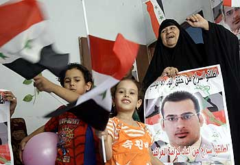 Relatives of the Iraqi reporter Muntazer al-Zaidi celebrate at his house