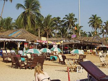 Tourists relax at a Goa beach