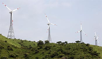 Power-generating windmill turbines at the Suzlon wind farm at Sanodar village
