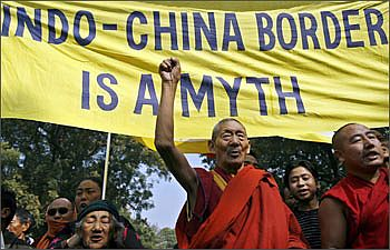 Tibetan exiles shout slogans during a protest against the visit of Chinese Deputy Foreign Minister Dai Bingguo in New Delhi
