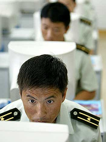 Chinese troops learn to use computers at a military base in Tianjin