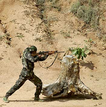 A file picture: A paramilitary trooper trains at the Jungle Warfare School in Kanker village, Chhattisgarh