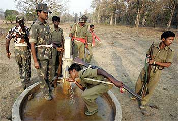 A file picture: Security personnel drink water while patrolling in Maoist territory in Bangapal