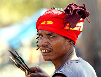 A tribesman carrying arrows at a camp run by the Salwa Judum in Dornapal in Chhattisgarh