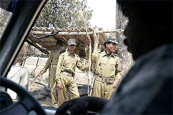 Tribal militia at a checkpost in a forest area in Kutru village, about 450 km south of Raipur