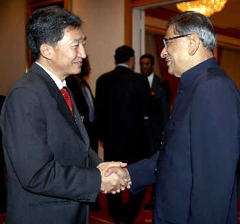 S M Krishna greets his Singapore counterpart George Yeo at the United Nations