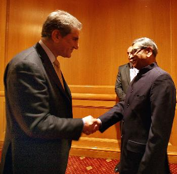 S M Krishna and his Pakistani counterpart, Shah Qureshi  greet each other during a SAARC Council of Ministers' working dinner reception in NewYork