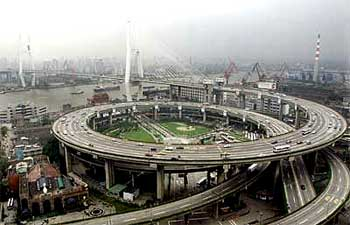 Smog hovers over Nanpu bridge funded by the Asian Development Bank in Shanghai
