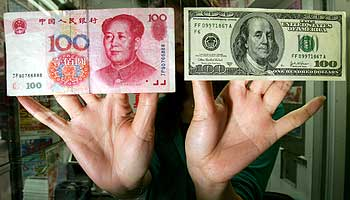 A Chinese renimbi 100 banknote, left, and a US$100 banknote