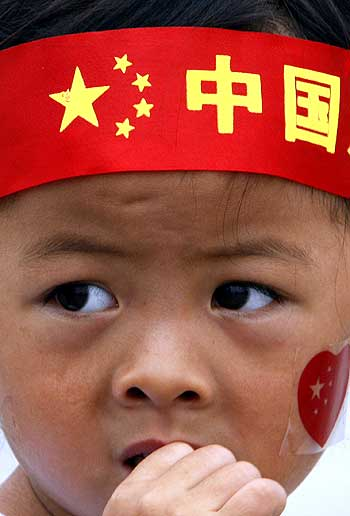 A boy with a Go China headband in Tiananmen Square