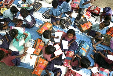 Children at an open air school on the outskirts of New Delhi