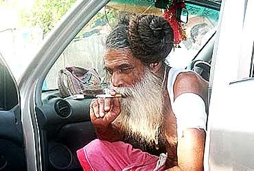 A sadhu enjoys a quiet moment