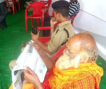 A sadhu catches up on the morning news