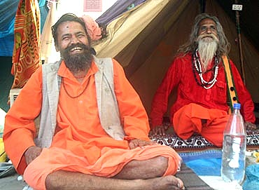 Some sadhus share a light moment at the Kumbh Mela
