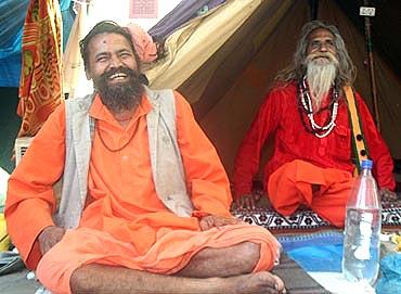Some sadhus share a light moment at the Kumbh Mela
