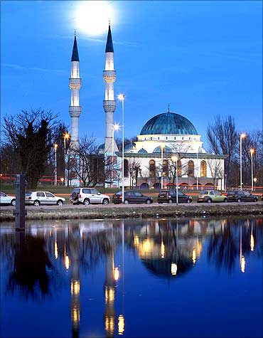 The moon shines over the Mevlana Mosque in Rotterdam