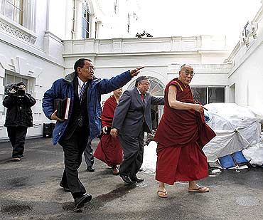 The Dalai Lama leaves the White House after his meeting with US President Barack Obama