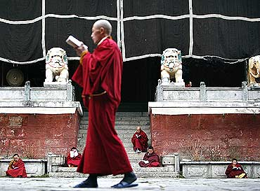 Monks from the Gelugpa sect of Tibetan Buddhism study at the Nanwu temple in Kangding, China