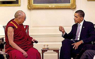 US President Barack Obama interacts with the Dalai Lama at the White House