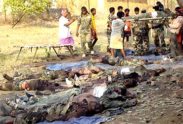 Bodies of policemen who were killed in a Maoist attack, seen lying on the ground