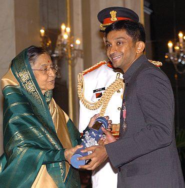 President Pratibha Patil presenting the Padma Shri Award to Narain Karthikeyan