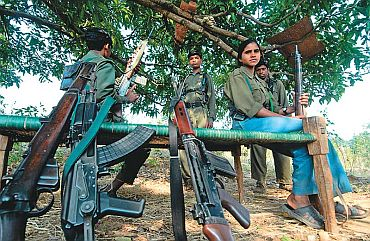 Maoists with their weapons