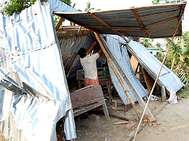A man tries to put up a make-shift shelter