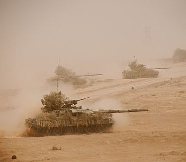 Pakistani army tanks take part in the military exercise