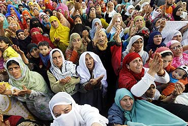 Kashmiri women attend a religious ceremony in Srinagar